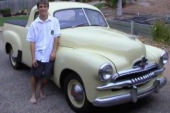 Our 1953 FJ Holden Ute. shortly after we purchased it. Nathan at age 16 is proudly standing with it.